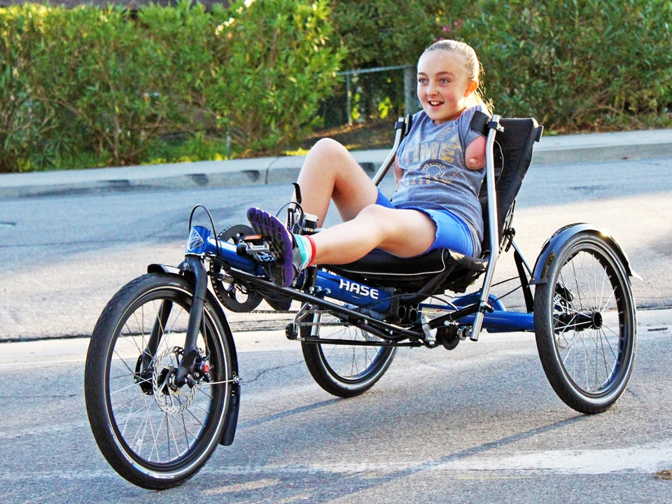 Emily riding her Hase Kettwiesel custom adaptive trike