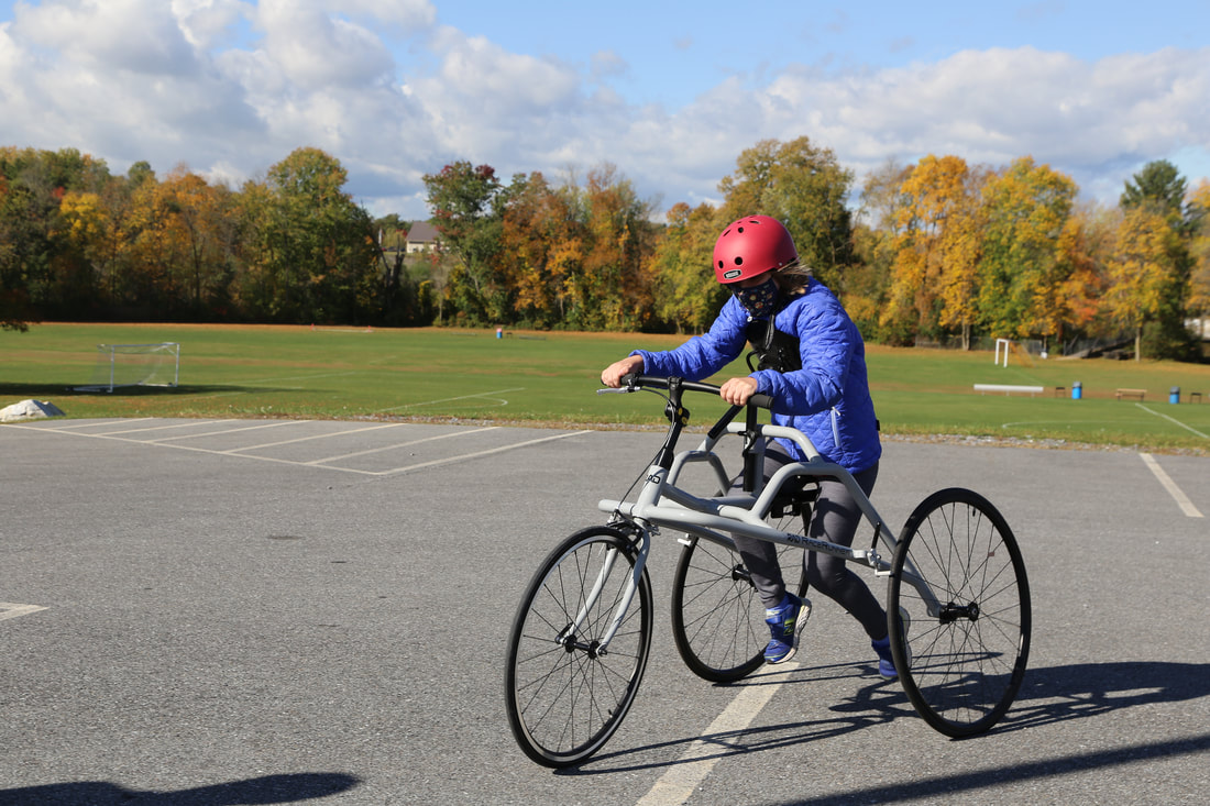 Picture of a girl on a RAD RaceRunner on a track